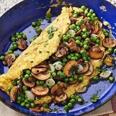 Farm omelette filled with green peas and mushrooms