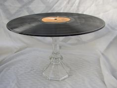 Record Cake Stand - cute for a 50's party! www.tablescapesbydesign.com https://www.facebook.com/pages/Tablescapes-By-Design/129811416695