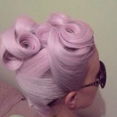 Ornate up-do with cee curls in wrapped Lavender hair.