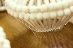 Teaser - of a beaded piece, light shinning through with contrasting shadows.