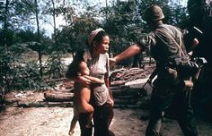 Marine leading a sweep into a fortified village pushes woman so he will have an unobstructed field of fire. Paul Schutzer—The LIFE Picture Collection/Getty Images Caption from LIFE.