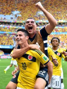 James Rodriguez of Colombia celebrates scoring his team's first goal with his teammate Faryd Mondragon during the 2014 FIFA World Cup Brazil Group C match between Colombia and Cote D'Ivoire at Estadio Nacional on June 19, 2014 in Brasilia, Brazi