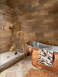 Beautiful Copper Tub and Glass Tile Shower with Natural Stone by Betty Lou Phillips