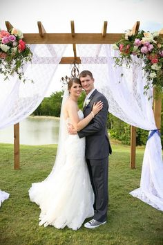 I love their wedding arbor/arch thing and the setting.. So pretty