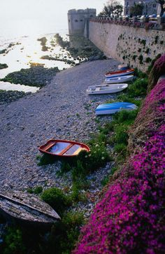 'Ancient sea wall and coastline in the historic centre of Alghero.' by Lonely Planet