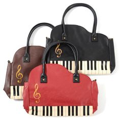Perfect for music lovers everywhere, these elegant tote bags each come in the shape of a grand piano! Available in black, brown or red each of the bags has a keyboard at the bottom with a treble clef above and two long black handles at the top. Inside, the bag had one large central compartment which fastens with a popper plus some smaller slot pockets at the back for your smartphone or other small...