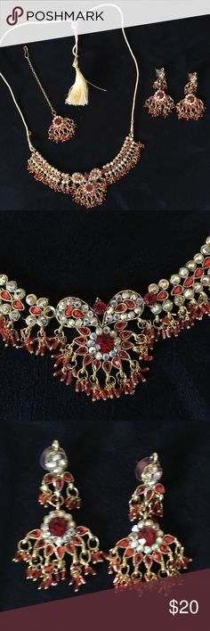 Indian Bollywood necklace, earrings & tikka set Indian Bollywood necklace, earrings & tikka set. Costume jewelry in red & gold. (My daughter dances Indian Bollywood but doesn't need this set anymore.) It goes great with the kiddie princess sari that is also listed in my Poshmark closet. 😉🇮🇳💃🏻💚💛🧡 Jewelry