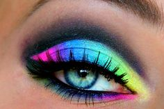 Rainbow neon shadows with a dark contrast above crease. LOVE how the colors make her eyes pop!