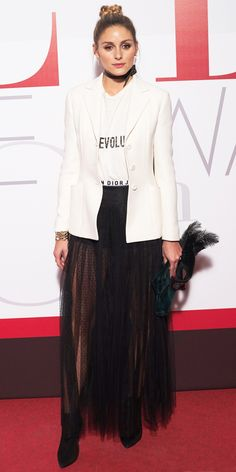 Olivia Palermo joined in on the dio(r)evolution when she arrived on the red carpet in Dior: a printed tee (with the graphic stamped across the front), a black pleated dotted tulle skirt, and an ecru wool blazer. A black ribbon choker, a gold cuff, and black suede boots completed her look.