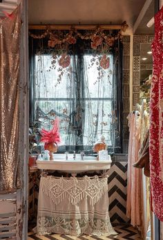 Home tour Inspiration: Sera of London — The Decorista - love the skirt on the bathroom sink!