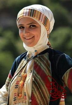 Middle East | Portrait of a woman wearing traditional clothes, Palestine