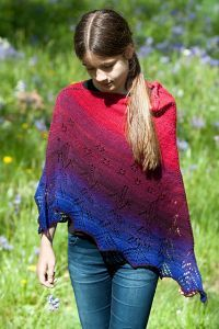 Free knitting pattern. Pattern category: Poncho, Shawls. Lace weight yarn. 750-900 yards. Features: Beads, Lace. Intermediate difficulty level.