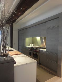 Gray kitchen cabinets in Meatpacking district loft