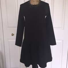 Sale!! Asos black dress 4 Super cute black dropwaist dress.  Zips up the back. 79% polyester 18% viscose 3% elastine. Dress has pockets :) Necklace sold separately in another listing. ASOS Dresses