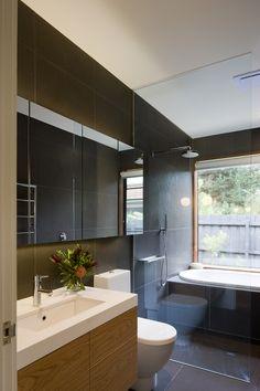 grey floor to wall tiles + timber vanity