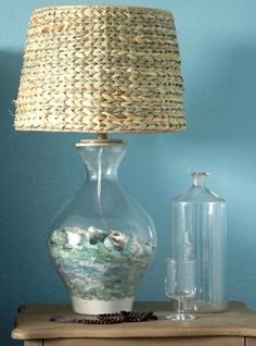 Beach lamp. Fillable glass table lamp with seaglass collection. Sources where to buy fillable lamps: http://www.completely-coastal.com/2008/08/fillable-sea-shell-lamps.html Showcase your treasures in a lamp base.