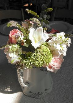 Centerpeice with frilly tulips, stock, sedum, mint and roses