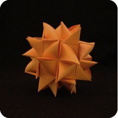 A paper Moravian Star Ball is made of six Moravian Stars. The process involves inserting the tips (points) of the stars under layers of paper so they are Origami Star Box, Origami Ball, Origami Fish, Origami Paper Art, Origami Stars, Paper Crafts, Origami Folding, Oragami, Paper Folding