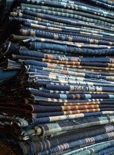 Tall stack of hand loomed cotton plaids and stripes from the mid to late 19c through the 1940's via sri threads