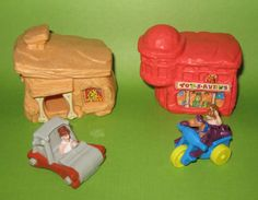 Flintstones toys from when the movie came out. I think McDonalds gave these away in the Happy Meals?