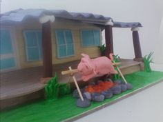 Camp fire with a Pig on a spit! Log cabin fondant cake, all eideable!