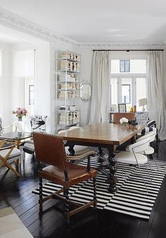 love the curtains....and the rug....table legs are a perfect contrast!