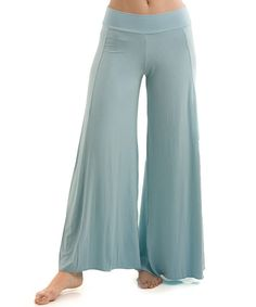 Casual, breathable and made with a soft fabric, these palazzo pants are easy to wear from sun salutations to grocery store maneuvering. Their wide silhouette, with a form-fitted waist, allows flexibility for the day's demands.95% viscose from bamboo / 5% spandexMachine wash; tumble dryImported