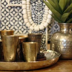 village stores.com.au Description: Each hand-engraved brass lassi cup has it's own individual personality. Originally used for drinking, these lovely decorative cups make great candle holders or planters for a quirky touch to your decor.Material: BrassColours Available: VariousDimensions: 10-12cm high (approximately)8cm diameter (approximately)