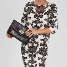 Everly damask pattern shift dress White 3/4 length sleeve shift dress with beautiful black damask pattern, by Everly. Size Small. Bottom hits just above knee. Zips up back. 100% polyester. Gorgeous dress & only wore twice! Everly Dresses