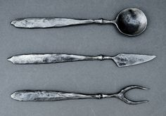 Replica of medieval banquet cutlery.  I wish there was a date on these.