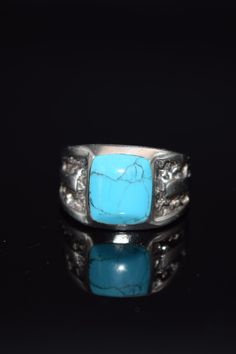 This magnificent ring was made by Silver Cloud. The ring is a thick sterling silver with a wonderful piece of blue turquoise.  The ring is unisex. Hallmarked (c) SC in a cloud Sterling 7.9 Grams (total) Size 9 1/2