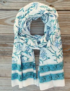 Vintage Floral Scarf: A light-weight cotton scarf with a retro blue, teal and green floral hand block print. Your purchase helps provide a secure job with fair wages and a positive working environment
