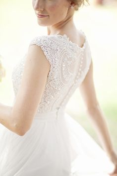 Lace and/or buttons. Lace not necessary, could be plain. Best one neckline-wise. Simple and pretty