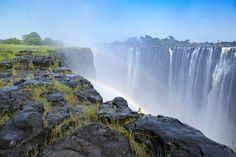 Victoria Falls is between Zimbabwe and Zambia and each side offers different views and sights. From this side you can see a light rainbow and the water streaming from the Zambezi.   Vic Falls Travel organises trips to Victoria Falls, taking you to areas where you too can capture photos like this!