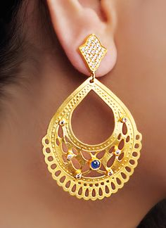 Urban Dhani brings to you a pair of statement earrings studded with Lapiz Lazuli stones. Both the top and the drop are made of metal. While the top is textured, the drop features delicate filigree work. Enhancing the look of the drop are the Lapiz Lazuli stones studded in it. Best worn with traditional attire, these statement earrings are a must have for a look that makes a fashion statement.