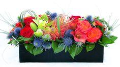 Vibrant spring flower arrangement .
