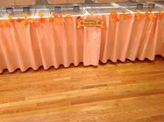 Food table with peach table skirt and fall leaves