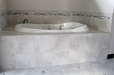 Light Grey Tile Tub Surround with Grey Tones Pattern Accent Wall Tile Tub Surround, Bathtub Remodel, Grey Tiles, Bathroom Tubs, Bathroom Ideas, Bathroom Furniture, Easy Diy, Olaf, Chair