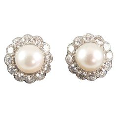 Pearl Diamond Platinum Rosette Earrings | From a unique collection of vintage clip-on earrings at https://www.1stdibs.com/jewelry/earrings/clip-on-earrings/