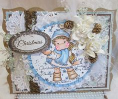 Magnolia Tilda Christmas card using a spellbinders die and laces and trims.