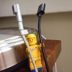 Life hack: use Lego figurines to hold your cords. May we suggest a female astronomer Lego to do the job?