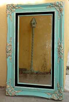 Aged mirror with custom color Chalk Paint® and waxes