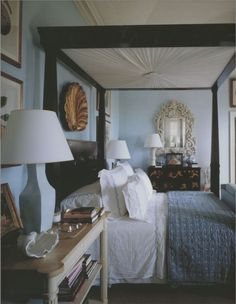Shell mirror over chest, Gilt oversized clam shell wall decor, bed side table.  Bunny Williams coastal home