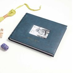 A special hand crafted leather album with a textured pattern to lend it a unique appeal. This keepsakes comes with a window on the album cover which can carry the couple's/relevant photo with name embossed in gold at the bottom