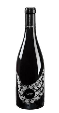 Isidro Ferrer. 12 lunas. Imagen gráfica y etiqueta serigrafiada sobre vidrio para los vinos del Somontano 12 lunas. Vinsom, 2009
