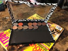 DIY makeup case  What you will need: Adhesive Magnetic Sheets An old DVD case Duct Tape (with fun designs!) Scissors (to cut the duct tape) Box cutters
