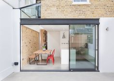 External View: Minimalist Windows & doors by Thomas & Spiers Architects I like the exposed brick