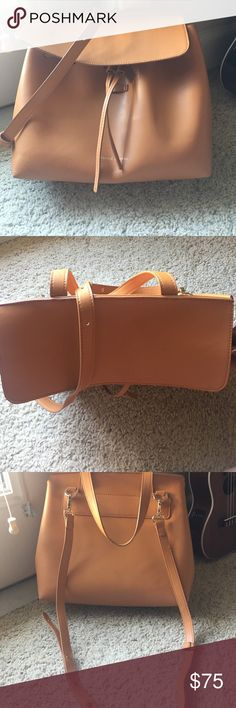 Mansur Gavriel Lady Bag Not Authentic. I bought this to help me decide whether or not I wanted the authentic one. This bag is great and in excellent condition. It's basically identical to the authentic one, but not with as high of quality leather. The only imperfections are some very, very light stains on the bottom of the bag. This is a great bag to help you decide if you want to invest in the real one! Mansur Gavriel Bags Shoulder Bags