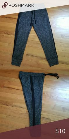 Dark grey sweatpants Purchased from Marshalls. No tags but never worn. Dark grey with white spotting and black stripe down side. Snug fit but not too thick. As for the material it is polyester and cotton. American Eagle Outfitters Pants Track Pants & Joggers