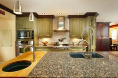 Modern country kitchen with two different countertop surfaces. #kitchenrenovation #kitchens #interiordesign  www.karry.ca